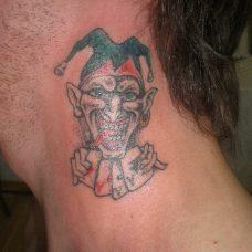 Джокер - татуировка на шее